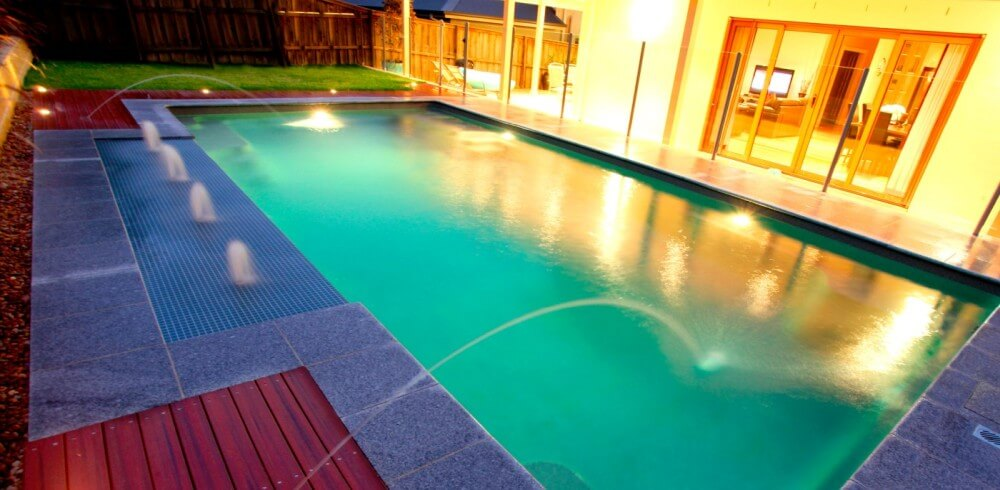 Donehues Leisure Pool water features Swimming pool with deck jets and sunpod