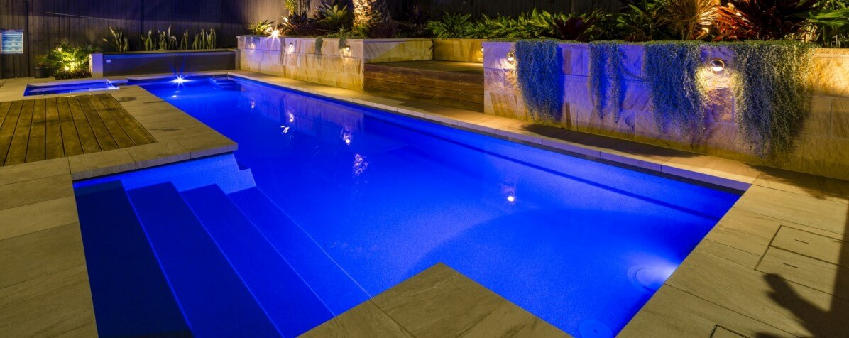 Donehues Leisure Compass fibreglass pools Fastlane lap pools and spa combo with pool lights on